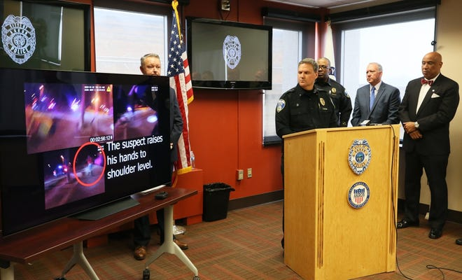 Akron Police Chief Kenneth R. Ball II, from left, Police Lt. Michael Miller, Akron Mayor Dan Horrigan and Deputy Mayor Charles Brown hold a news conference Feb.7 and watch a video from police body cameras of the Jan. 7 shooting of Elijah Cade after a high-speed chase.
