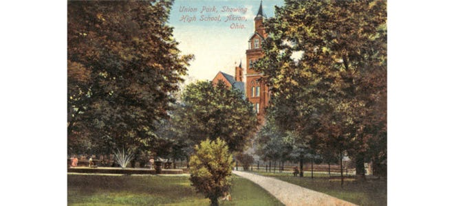 Akron High School's 160-foot clock tower looms over Union Park at the turn of the 20th century. The park was bounded by Mill, Forge and College streets. The fountain was built in 1894.