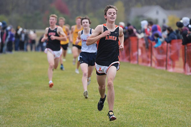 Ames' Nicholas Grandgenett comes on strong toward the finish line during the boys' race at the Class 4A state qualifying cross country meet held at the Southeast Polk cross country course Wednesday in Pleasant Hill. Grandgenett stepped up to place 10th and qualify for state.