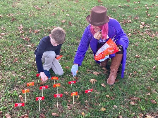 Lynn Rutecki and son, Jake, are planting a candy garden to match their Halloween costume theme of Willy Wonka and the Chocolate factory outside their Middletown, Penn. home.
