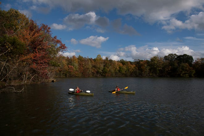 Kayakers paddle along as Willingboro Lakes Park officially opens Wednesday, Oct. 21, 2020 in Willingboro, N.J.