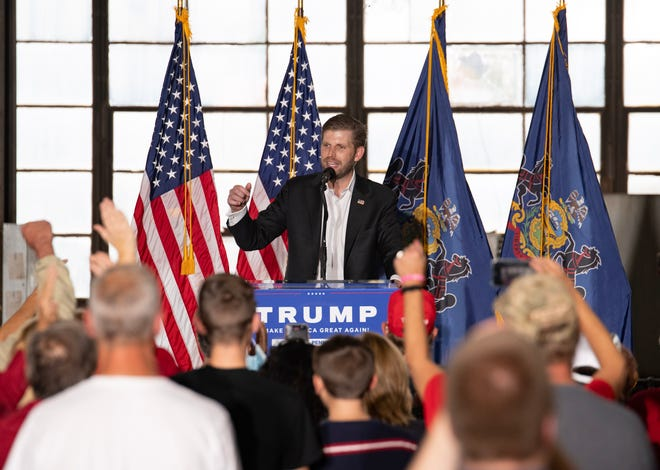 Eric Trump, son of President Donald Trump, speaks to a crowd Thursday afternoon during a Make America Great Again rally in Ambridge.