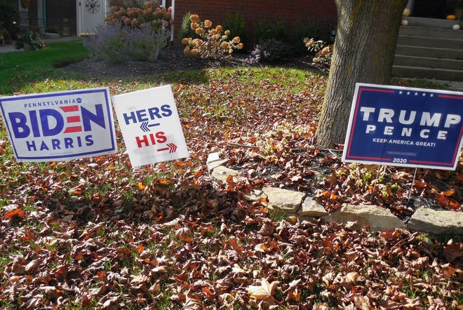 """These """"his"""" and """"hers"""" candidate signs in the front yard of a Taylor Street home in Beaver sums up the political climate in the country: A house divided — but with a sense of humor."""