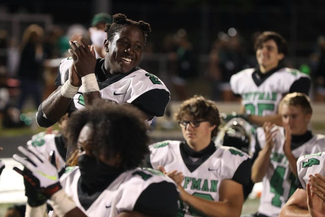 Bryon Threats of Dublin Coffman celebrates with teammates after a 24-17 win over Olentangy Liberty on Sept. 4. The teams play again Friday night in the Division I playoffs.