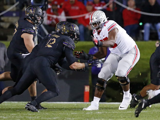 Ohio State tackle Thayer Munford, blocking against Northwestern in October 2019, said he was only 80% healthy last season but is full-go now.