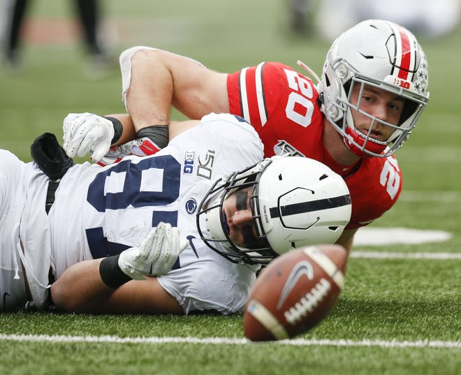 Ohio State linebacker Pete Werner (20), breaking up a pass intended for Penn State tight end Pat Freiermuth last year, will be called on to be more of a run-stopper on the strong side this year.