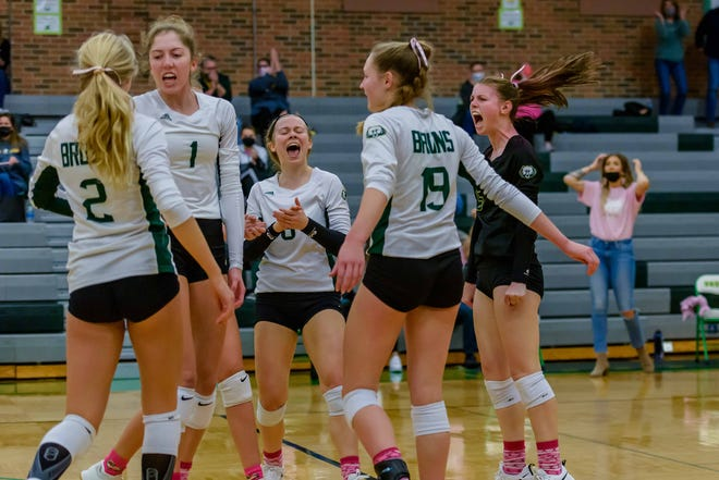 Rock Bridge players celebrate after sweeping Hickman in a Central Missouri Activities Conference match Wednesday night at Rock Bridge High School.
