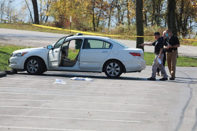 Columbus police said Kathleen Boyuk, 75, of Norwich Township, was found Thursday morning unresponsive and slumped over the wheel of this white Honda with a gunshot wound to the chest in a parking lot at Griggs Reservoir Park on the city's Northwest Side.  Her attorney-husband, 77-year-old Walter Boyuk, was later arrested by homicide detectives and charged with murder in her death.