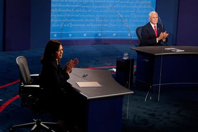 Democratic vice presidential candidate Sen. Kamala Harris, D-Calif., and Vice President Mike Pence applaud after they debated earlier this month in Salt Lake City.