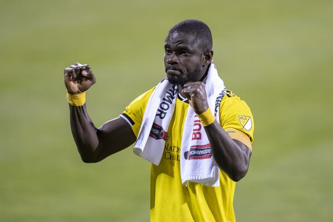 Defender Jonathan Mensah celebrates with fans in Mapfre Stadium after a shutout win over Nashville SC on Sept. 19.