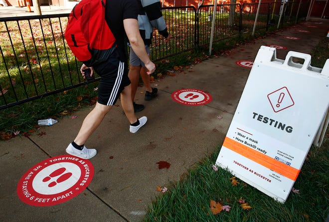 Students enter the Jesse Owens North Recreation Center on the Ohio State University campus for COVID-19 testing Thursday morning