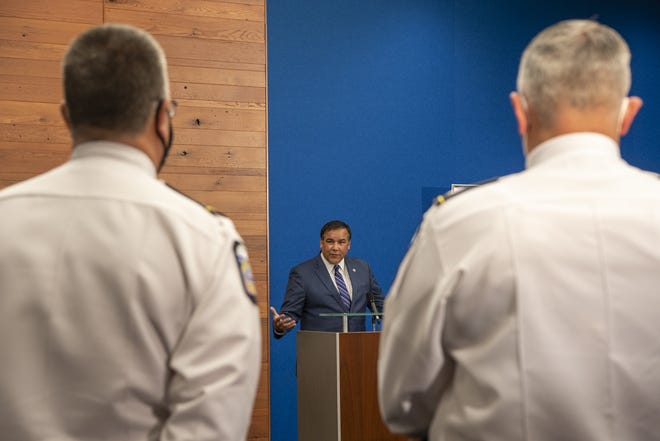 Columbus Mayor Andrew J. Ginther addresses ongoing and new initiatives to curb growing gun violence in the city during a news conference Thursday.