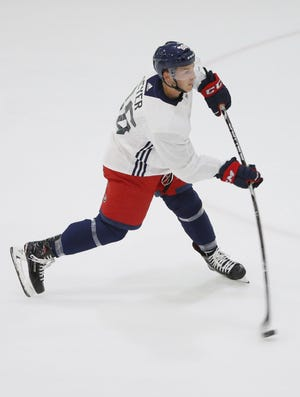 Forward Carson Meyer takes a shot during Blue Jackets development camp in June 2019.