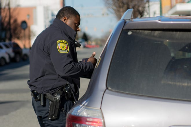 An Asheboro police officer performs a traffic stop.