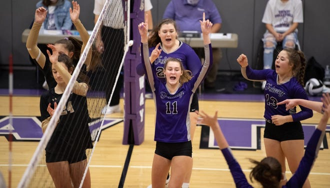 Katie Walker, Chloe Sherrieb and Hailey Massaro celebrate a point as Hathaway Brown players hang their heads. Triway beat HB in three sets.