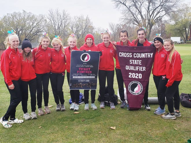 DCG girls cross country after capturing the state qualifying crown and their seventh straight state meet ticket on Wednesday, Oct 21 in Winterset.
