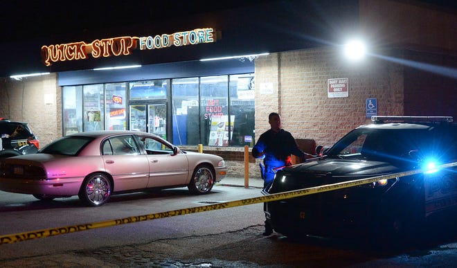 Erie Bureau of Police officers are investigating a shooting outside the Quick Stop Food Store at 408 W. 18th St., in Erie on Wednesday. A man, 40, was fatally shot in the incident and police are still looking for a suspect.