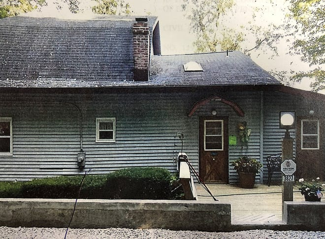 This is a photograph of a court exhibit that shows the house at 3827 Lake Front Drive, on Lake Erie off the foot of Powell Avenue in Millcreek Township. The house is at the center of an unusual court battle over its ownership.