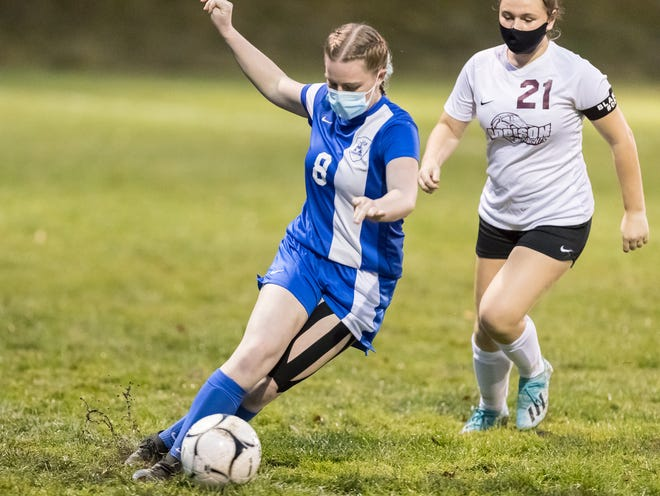 Alfred-Almond's Ali Hurd (8) dribbles away from the Addison defense Wednesday night.