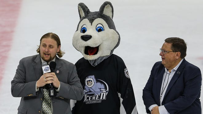 ECHL commissioner Ryan Crelin (left), the Jacksonville Icemen mascot Fang and Icemen president Bob Ohrablo announce during a game last January that Jacksonville's Vystar Veterans Memorial Arena will be the site of the 2022 ECHL All-Star game.