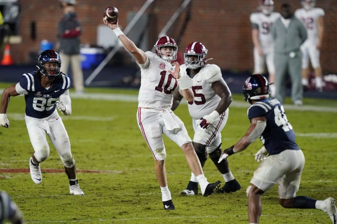Alabama quarterback Mac Jones (10), seen here throwing a pass during a historic 63-48 win over Ole Miss, and the Crimson Tide are part of a growing trend among SEC programs that feature a greater dependence on explosive offenses.