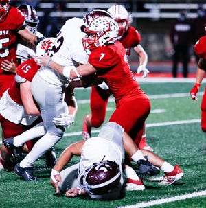 Glen Rose linebacker Jace Karels (7) stands up a Hillsboro ball carrier.