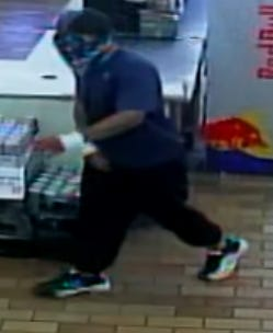 Lubbock police investigators seeking the public's help in identifying the masked armed robber who brandished a firearm at a dollar store clerk on Oct. 10.