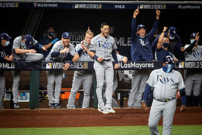 The Tampa Bay Rays celebrate after a home run against the Los Angeles Dodgers during Game 2 of the baseball World Series, Wednesday in Arlington, Texas. YIFFY YOSSIFOR/THE ASSOCIATED PRESS
