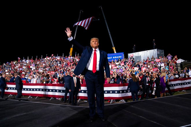 President Donald Trump waves to the crowd as he walks off stage after speaking at a campaign rally at Gastonia Municipal Airport, Wednesday, Oct. 21, 2020, in Gastonia, N.C.
