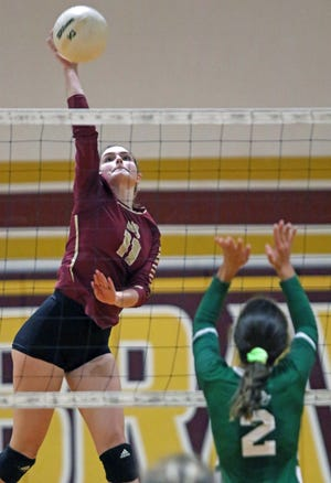 Lake Gibson's Haley Gartrell hits over Lecanto's Mackenzi Grey on Wednesday night in the Class 5A, Region 2 quarterfinals.