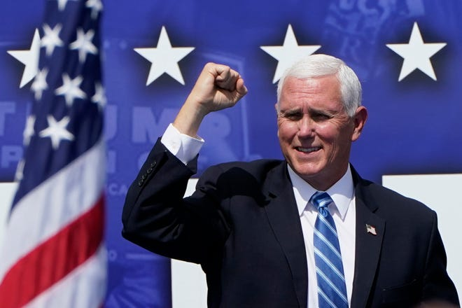 Vice President Mike Pence speaks during a campaign rally at the Cuban Memorial Monument on Oct. 15 in Miami. Pence will hold a rally for supporters of President Donald Trump on Saturday at Lakeland Linder International Airport.