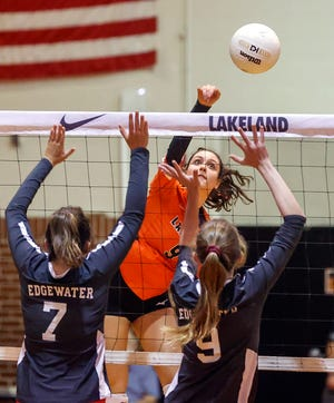 Lakeland's Grace Garcia fires a shot past Edgewater defenders Gracie Benson and Ellie Chancey.