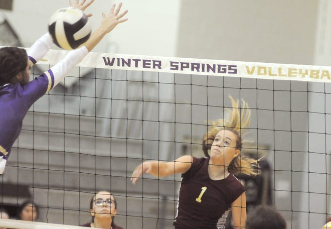 George Jenkins senior outside hitter Makenzie Sherrouse hits around Winter Springs middle blocker Hannah White for a kill during the Eagles' 25-17, 25-6, 25-20 loss in the Class 6A, Region 4 volleyball quarterfinals.