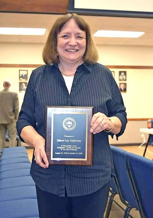 Moberly City Clerk Kay Galloway holds a plaque of appreciation Monday for her 44 years of service she received during the Moberly City Council meeting. Galloway will retire Nov. 1.