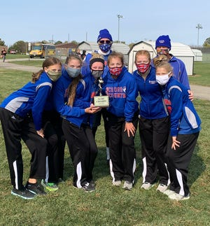 Moberly varsity girls cross country team won the 2020 North Central Missouri XC meet championship held Oct. 17 in Fulton. Lady Spartan runners are freshman Chloe Ross, seniors Isabella Ross and Maggie Crist, Malana Pence, junior AriAnna Wilkey and sophomore Anna Rivera. Also shown are head coach Greg Carroll and assistant coach Brian Hunsaker.