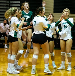 Forest celebrates its win in the third set to defeat South Lake in the 6A Region 2 quarterfinals, 25-22, 25-18 and 25-15.