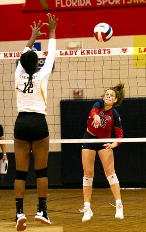 Vanguard's Sophie Reed with the hit at the net past Lake Minneola's Karissa McCoy. The Knights beat the Hawks in straight sets: 25-11, 25-16, and 25-17  in the 5A Region 2 quarterfinals Wednesday night.
