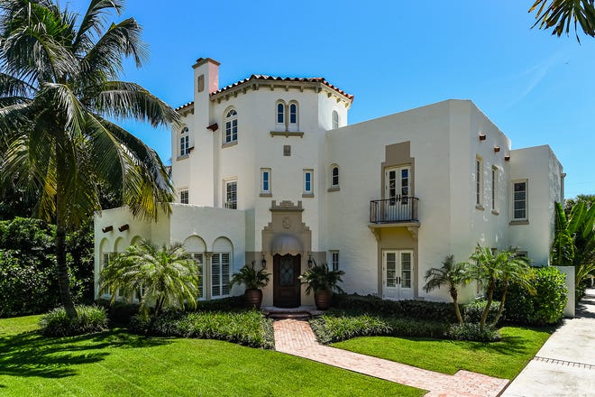 The Mediterranean-style house has a prominent three-story section that has been described as giving the 1920s-era landmarked house the look of a castle.