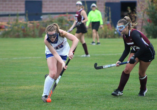 Winnacunnet High School's Carolyn Thompson (14) works against Timberlane's Emma Antkowaik during the second half of Wednesday's Division I field hockey playoff game in Hampton. Timberlane won 1-0.