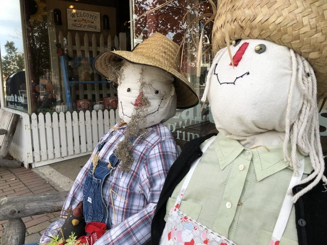 A scarecrow smiles for the camera while sitting on the bench in front of Hearth & Soul on Main Street in Kennebunk. As Halloween approaches, Kennebunk and other neighboring communities are approaching Halloween in different ways.