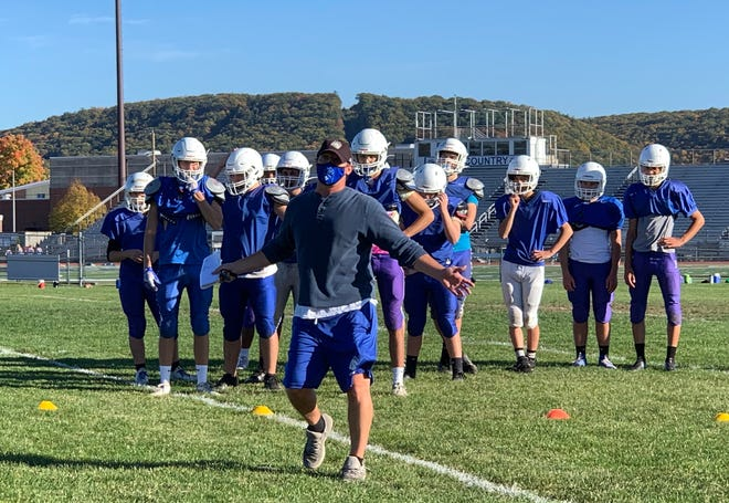 Pleasant Valley football coach Blaec Saeger, center, leads his team during practice on Oct. 14. The Bears are eyeing their first win since 2018 as they play East Stroudsburg North on Friday.