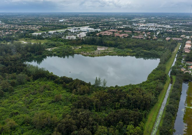 An 18-acre lake sits on the west side of the property being proposed for development as Lotis, a mixed-use project that would be on the west side of State Road 7 just north of Wellington Regional Medical Center in Wellington on Oct. 21. (GREG LOVETT / THE PALM BEACH POST)