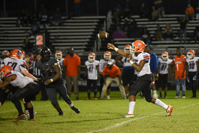 In this 2019 photo, Palm Beach Gardens quarterback Lynden Moss throws the ball during a game against Palm Beach Central. Moss returns after throwing for 1,500 yards and 20 touchdown last season.
