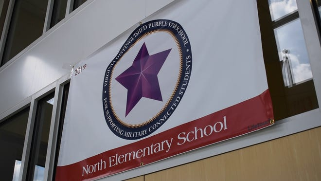 Walton and Harrison elementary schools in Prince George have been awarded the Purple Star Designation for supporting military students and families. This banner is from North Elementary, which was designated as a Purple Star School in 2019.