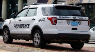 This file photo shows a Providence police cruiser. The Providence police are investigating after a man told them he was stabbed Wednesday night while taking out his trash. (The Providence Journal file / Kris Craig)