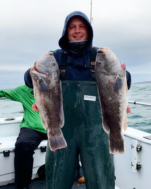 Bobby Bisset of Narragansett with tautog he caught while fishing on a Frances Fleet boat out of Point Judith last week.  [Courtesy of Dave Monti]