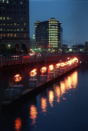 Braziers glow along the Providence River during a WaterFire installation in August 1997.