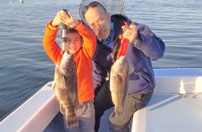 Xavier Wong, (seven years old) with his personal best eight pound tautog caught off Newport this week.  He and his father Jamie limited out with ten fish in about 3.5 hours of fishing. [Courtesy of Dave Monti]