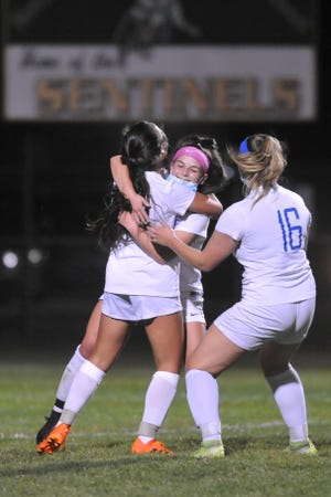 Riley Trudeau and the Cumberland girls soccer team celebrated after a goal against Smithfield last week; with the RIIL's postseason plan, the Clippers could be able to repeat this scene if they win the state title on Nov. 22.