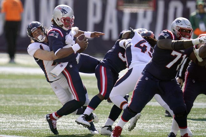 Broncos linebacker Anthony Chickillo, left, sacks the Patriots' Cam Newton during Sunday's game.